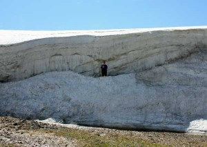 Me, photographed in a giant snowdrift on Sleeping Indian in early July.
