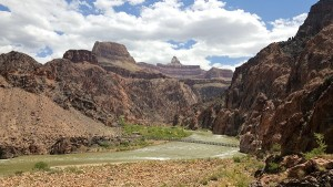 The Colorado River at the base of the Grand Canyon. Both footbridges are visible.